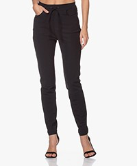 JapanTKY Romy Travel Jersey Slim-fit Pants - Deep Black