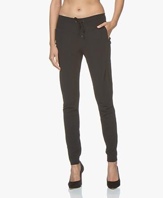 JapanTKY Gyta Travel Jersey Slim-fit Pants - Black
